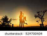 happy family in the park at the ... | Shutterstock . vector #529700404