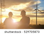 Small photo of Silhouette of engineer and foreman at wind turbine electricity industrial in sunset