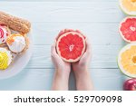 hands of a young woman holding... | Shutterstock . vector #529709098
