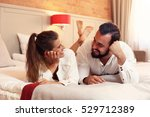 Stock photo picture showing happy couple resting in hotel room 529712389