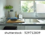 dishes next to sink in the... | Shutterstock . vector #529712839