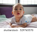 baby on the bed  in bedroom | Shutterstock . vector #529765570