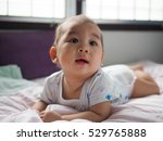 portrait baby on the bed in room | Shutterstock . vector #529765888