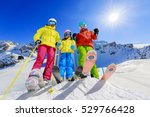 skiing family enjoying winter... | Shutterstock . vector #529766428
