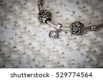 silver bracelet with charms.... | Shutterstock . vector #529774564