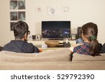 kids watching tv at home | Shutterstock . vector #529792390
