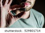 pill in hand guy   Shutterstock . vector #529801714