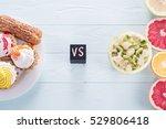choosing between fruits and... | Shutterstock . vector #529806418