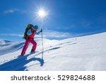 Woman Is Hiking In Snowy Winte...