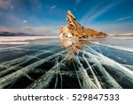 Transparent ice on Lake Baikal near Ogoy island. Siberia, Russia
