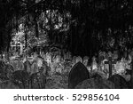 Tombstones And Graves In A...