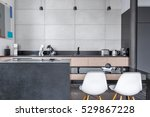 Modern Kitchen With Black Tabl...