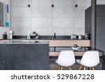 Modern Kitchen With Black Tabl...