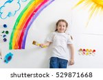 kid painting rainbow | Shutterstock . vector #529871668