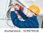 electrician examining current... | Shutterstock . vector #529879018