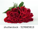 Stock photo one dozen red roses bundled together water droplets on pedals 529885813