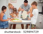 happy family cooking together... | Shutterstock . vector #529894729