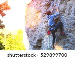 a young woman with a rope... | Shutterstock . vector #529899700
