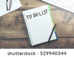 """keyboard and notepad with text """"...   Shutterstock . vector #529940344"""
