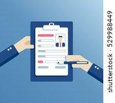 hands of businessman fill a... | Shutterstock .eps vector #529988449