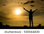 silhouette man holds gun. | Shutterstock . vector #530066830