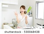 asian woman with apron peace...