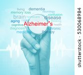 Small photo of hand holding stethoscope with Alzheimer's disease word. medical concept