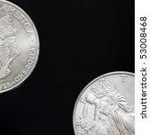 Two Silver Shiny Dollar Coins...