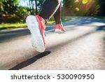 female runner jogging down an... | Shutterstock . vector #530090950