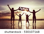 happy family jumping on the... | Shutterstock . vector #530107168