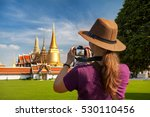 woman tourist in hat taking a... | Shutterstock . vector #530110456