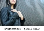 woman wearing leather jacket... | Shutterstock . vector #530114860