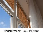 window with color roll blinds... | Shutterstock . vector #530140300