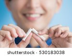 Small photo of man quit smoking with blue background, asian