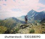 rock climber reaching for his... | Shutterstock . vector #530188090