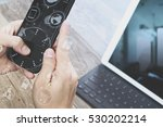hand using mobile payments... | Shutterstock . vector #530202214