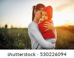 beautiful young mother holding... | Shutterstock . vector #530226094