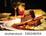 Small photo of Close up of braised beef short rib on dinner table. Selective focus.