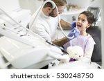 little girl having dental... | Shutterstock . vector #530248750