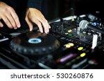 dj mixer with dj's hands | Shutterstock . vector #530260876