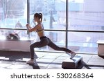 Small photo of fitness instructor doing aerobics aerobics dancing exercises in sport club with step