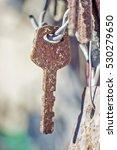 Hanging Old Rusty Key