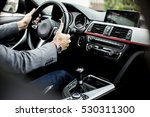 young man driving in the ... | Shutterstock . vector #530311300