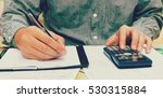 man using calculator and... | Shutterstock . vector #530315884