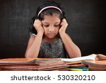 a little girl does her homework ... | Shutterstock . vector #530320210
