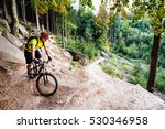 mountain biker riding on bike... | Shutterstock . vector #530346958