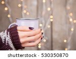woman in cozy sweater holding a ... | Shutterstock . vector #530350870