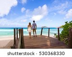 young couple walking to exotic... | Shutterstock . vector #530368330