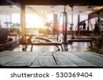 fitness gym and wooden table... | Shutterstock . vector #530369404