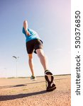 Small photo of Sport exercise, fitness, workout. Young athlete, runner in shoes. Outdoor activity, endurance. Active person road training. Healthy lifestyle. People in motion on sunset.